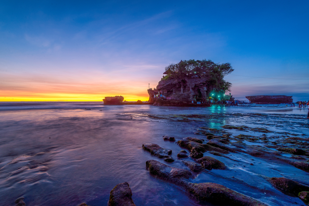 Visit Tanah Lot at sunset for the perfect Insta-shot.