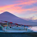 Jemeluk Bay has stunning views of Mt. Agung at sunset.